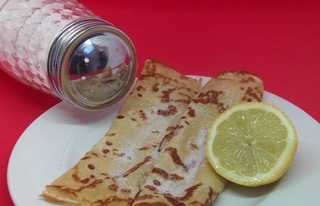 french pancake with lemon and sugar